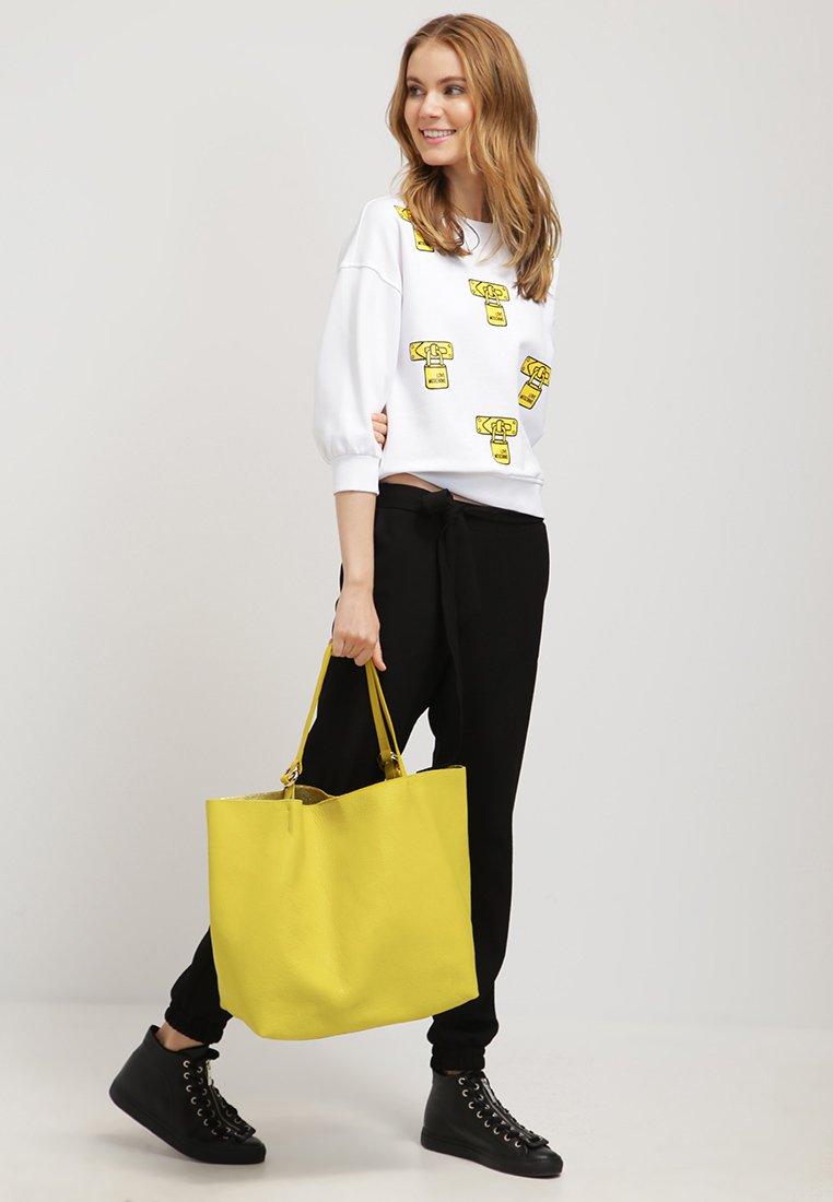 Coccinell Tasche gelb